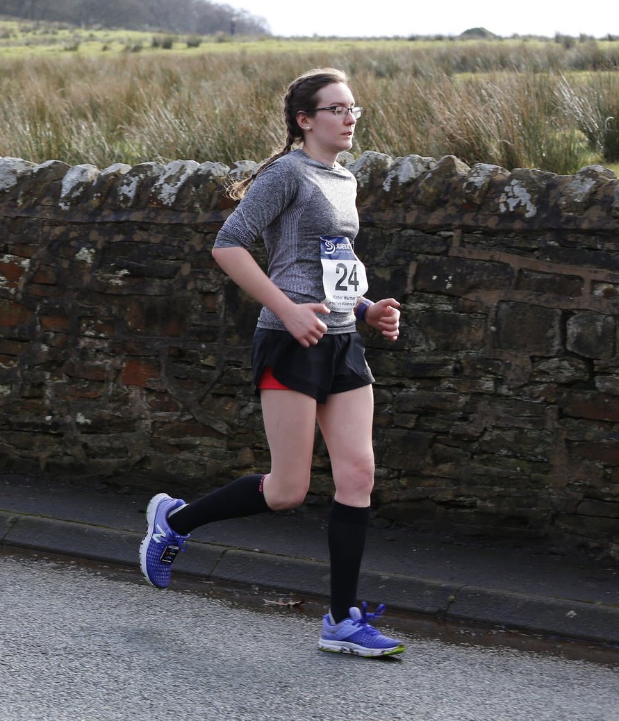Girl running with race bib number 24   awaywithkatie.com
