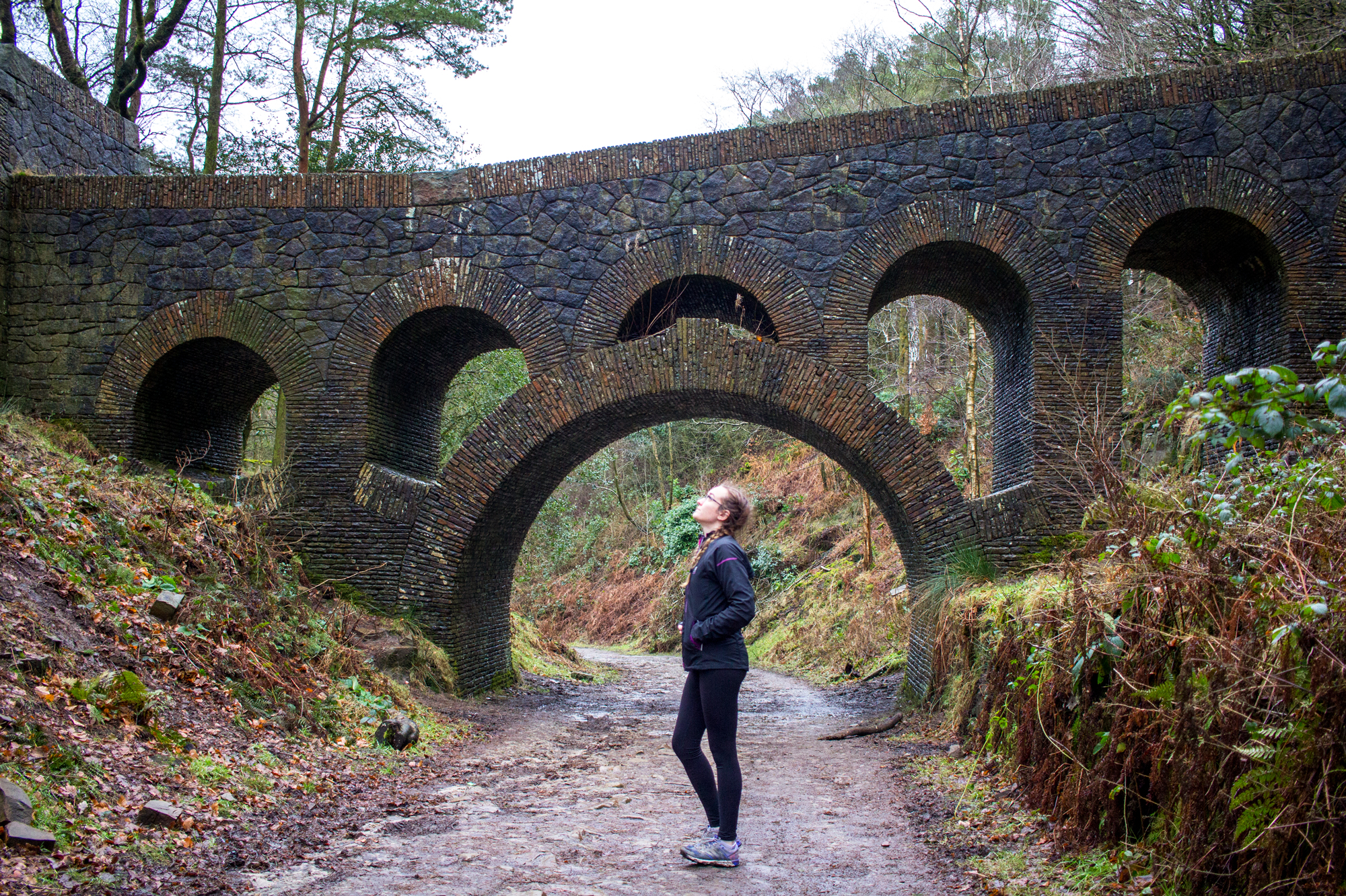 Running on a Treadmill Vs Running Outside on Roads or Trails | Katie stood under bridge at Rivington | awaywithkatie.com