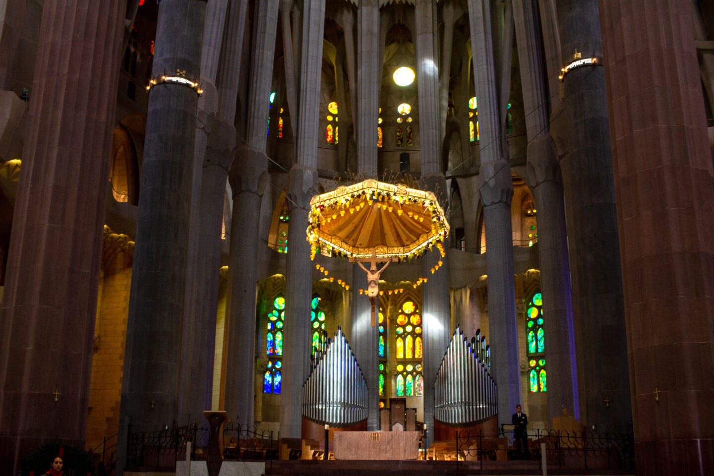 Inside Sagrada Familia at front with Christ statue.