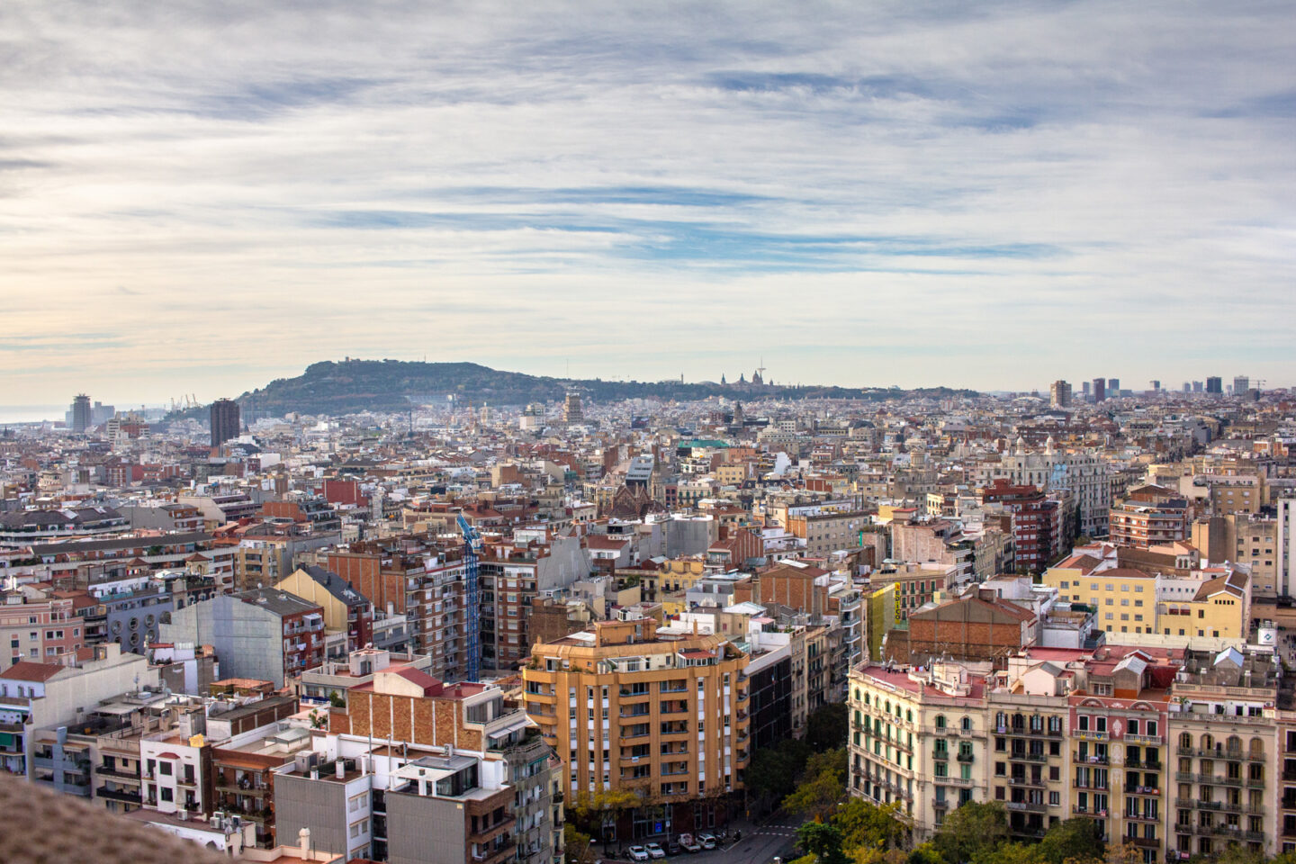 View of Barcelona city from the Passion Tower. Montjuic can be seen in the far distance.