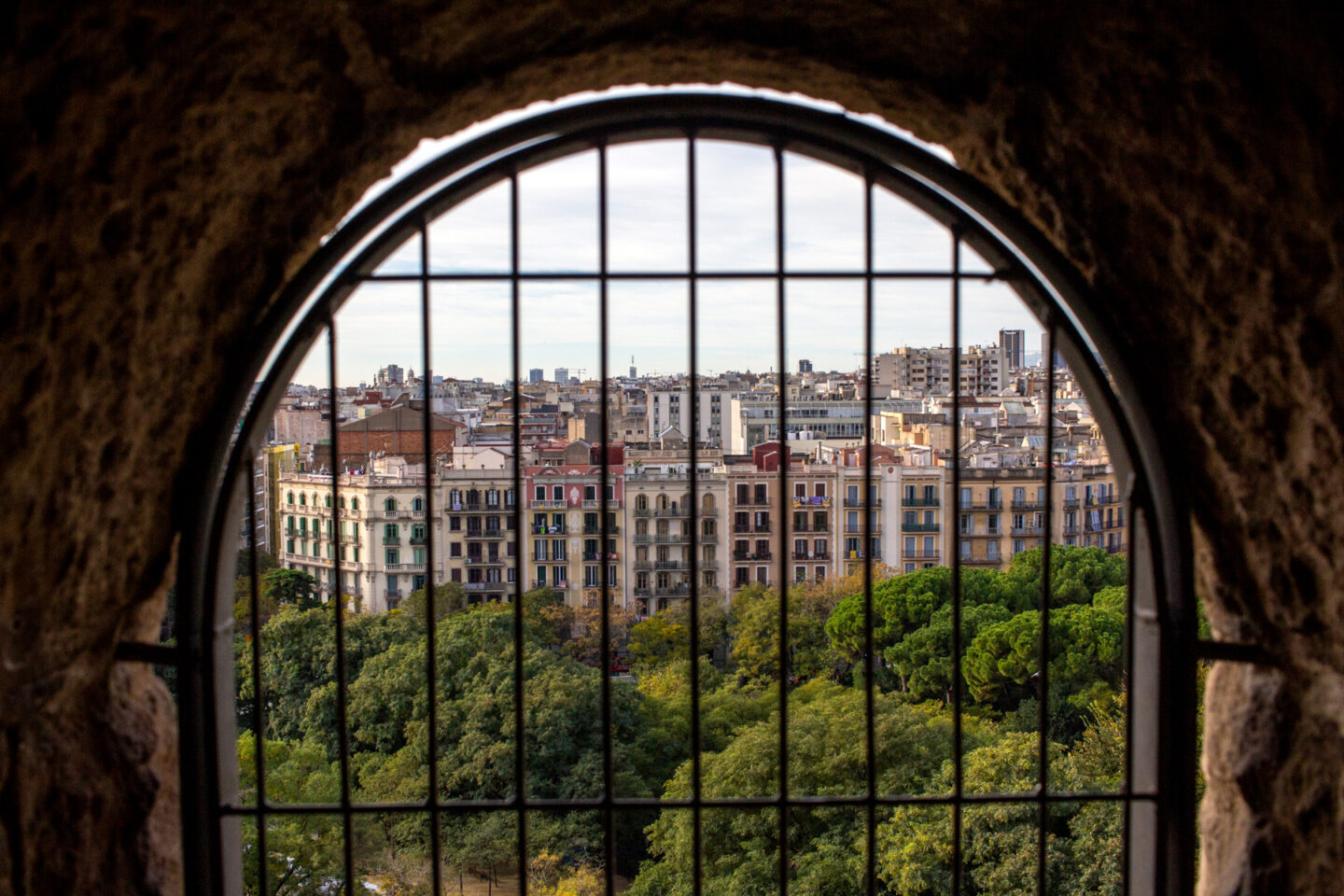 Barcelona pictured through a gated window.